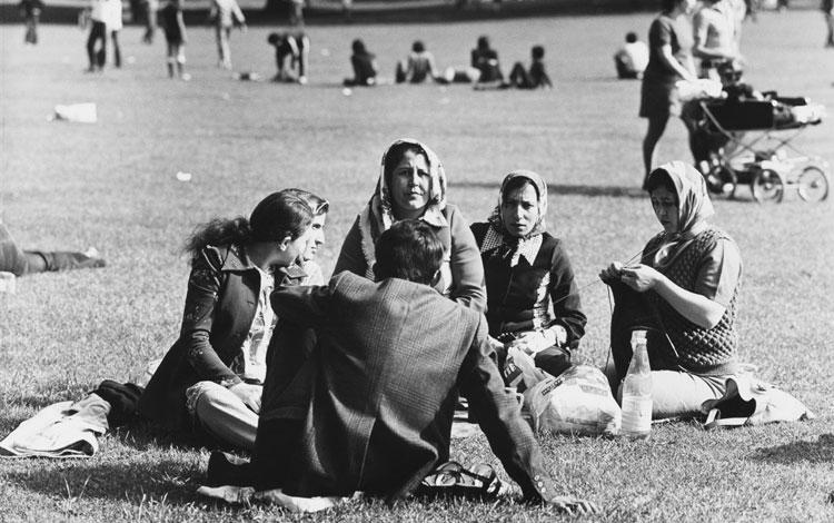 Turcos descansando en un parque alemán