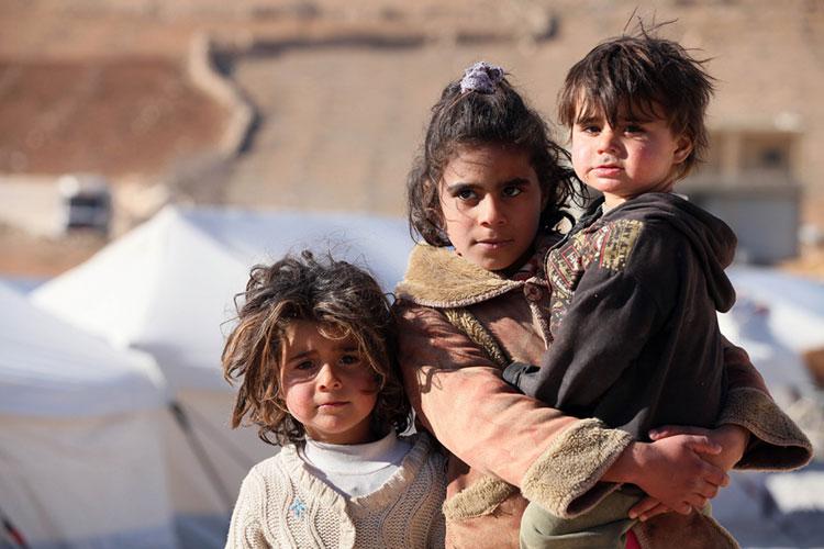 Niños sirios posando ante la cámara